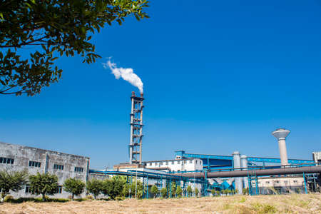 Iron and steel works under the blue sky and white clouds 新闻类图片