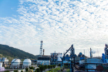 Steel works factory with blast furnace under the blue sky