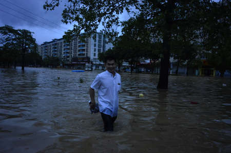 On September 17, 2018, typhoon Mangosteen brought heavy rains and caused floods in Yangchun City, Guangdong Province. Редакционное