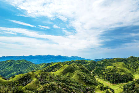 Mountain shrubs and meadows under blue sky and white clouds in Jilongding, Yangchun City, Yangjiang City, Guangdong Province