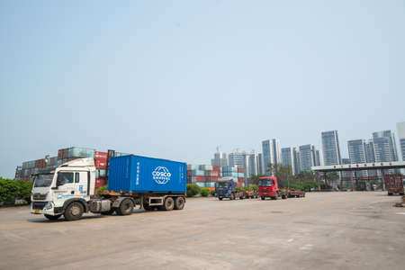 Haikou Port Container Terminal, Haikou City, Hainan Province, trucks in transit