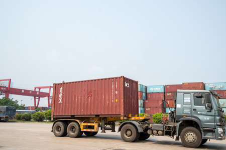 Haikou Port Container Terminal, Haikou City, Hainan Province, vehicles in transit Editorial