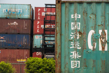 Haikou Port Container Terminal, Haikou City, Hainan Province, transported vehicles and containers stacked at the dock