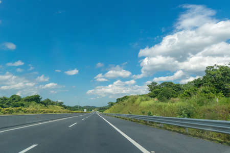 Highway under clear sky during the day Stock Photo