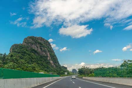 Highway through karst landforms