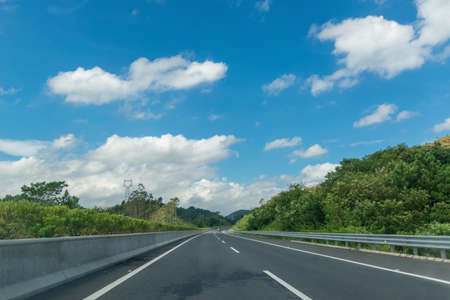Blue sky and white clouds and high speed highway