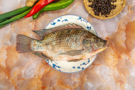 A plate of fresh tilapia