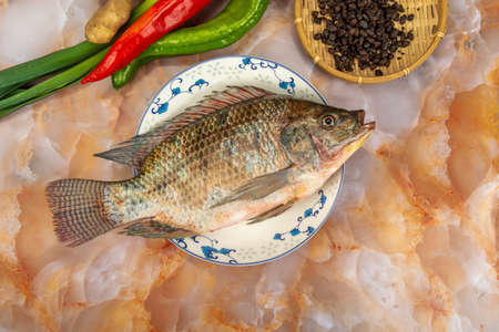 A slice of tilapia with ingredients