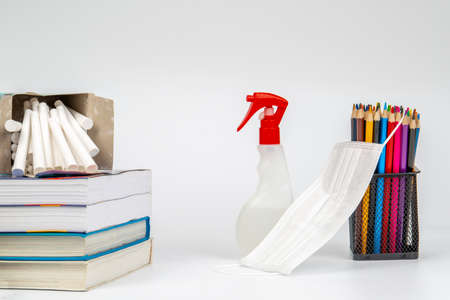 Educational still life material with mask and sanitiser on white background 免版税图像