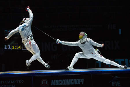 finals: MOSCOW, RUSSIA - MAY 30, 2015: Romanias Tiberiu Dolniceanu against Germanys Matyas Szabo in the finals of the mens individual event at the 2015 Moscow Sabre international fencing tournament.