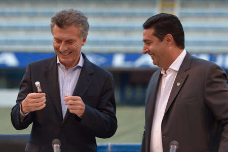 elected: BUENOS AIRES, ARGENTINA - DEC 2, 2015: Newly elected president of Argentina Mauricio Macri L at ceremony to honor him for his work as President of Boca Juniors between 1995 and 2007 with president of Boca Juniors Daniel Angilici R