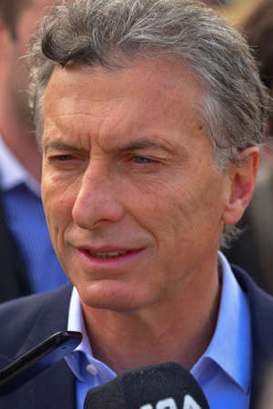 speaks: BUENOS AIRES, ARGENTINA - OCT 14, 2015: Buenos Aires mayor and presidential candidate Mauricio Macri, speaks to journalists as rural producers CRA members demonstrate against government policies. Editorial