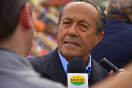 senator: BUENOS AIRES, ARGENTINA - OCT 14, 2015: National senator and presidential candidate Adolfo Rodriguez Saa, speaks to journalists as rural producers demonstrate against government policies.