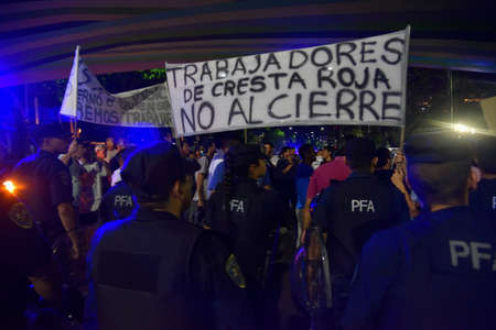 law school: BUENOS AIRES, ARGENTINA - NOV 15, 2015:  Workers of poultry company Cresta Roja protesting outside the University of Buenos Aires Law School, during presidential debate in Buenos Aires.