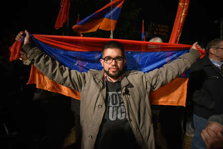 genocide: Buenos Aires, Argentina - Apr 25, 2016: Demonstrator holding the flag of Armenia during a march for the recognition of the Armenian Genocide in the Ottoman Empire on April 25, 2016 in Buenos Aires.
