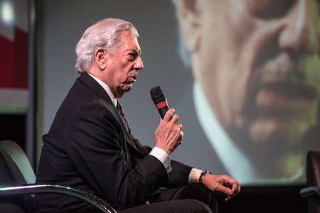 speaks: Buenos Aires, Argentina - May 6, 2016: Nobel Laureate in Literature Mario Vargas Llosa speaks during the presentation of his book Cinco esquinas as part of Buenos Aires International Book Fair at La Rural on May 06, 2016 in Buenos Aires, Argentina.