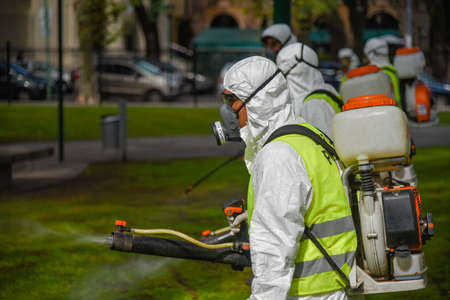 aedes: Buenos Aires, Argentina - March 3, 2016: Employees of the Ministry of Environment and Public Space fumigate for Aedes aegypti mosquitos to prevent the spread of zika virus and Dengue fever in park.