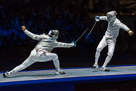 sabre: Moscow, Russia - May 30, 2015: Unidentified professional fencers in the finals of the mens individual event at the 2015 Moscow Sabre international fencing tournament.