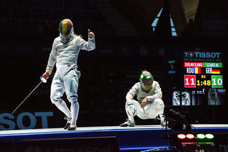 sabre: Moscow, Russia - May 30, 2015: Romanias Tiberiu Dolniceanu against Germanys Matyas Szabo in the finals of the mens individual event at the 2015 Moscow Sabre international fencing tournament.