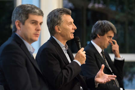 marcos: Olivos, Argentina - May 6, 2016: President of Argentina Mauricio Macri (C), Finance Minister Alfonso Prat-Gay (R) and Cabinet Chief Marcos Pena during a press conference at the presidential residence Editorial