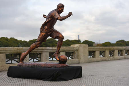 paseo: Buenos Aires, Argentina - Jun 28, 2016: The sculpture of the soccer star Lionel Messi at the Paseo de la Gloria in Buenos Aires.