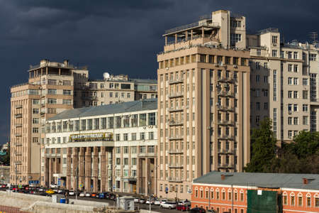 constructivism: Moscow, Russia - Jun 19, 2014: The House on the Embankment with the Moscow State Estrada Theatre at the Bersenevskaya embankment. It was completed as the Government Building for the Soviet elite.