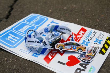 vw: Moscow, Russia - Apr 18, 2015: VW Polo Cup stickers and trinkets lie on a asphalt during the Rally Masters Show 2015 at the Krylatskoye District.