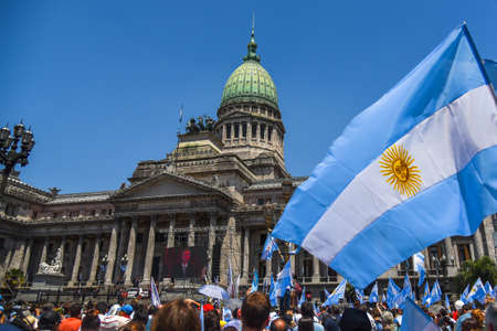 argentinean: Buenos Aires, Argentina - Dec 10, 2015: Supporters of the newly elected Argentinean president wave flags on inauguration day at the the Congress.