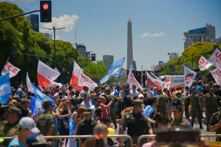 julio: Buenos Aires, Argentina - Dec 10, 2015: Supporters of the newly elected Argentine president cross the 9 de Julio Avenue in front of the Obelisk. Editorial
