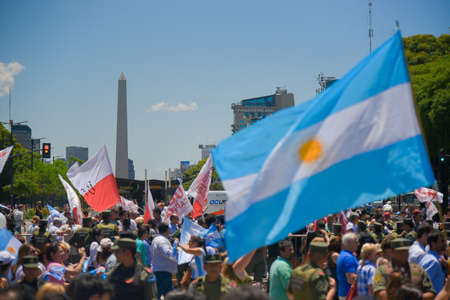 obelisco: Buenos Aires, Argentina - Dec 10, 2015: Supporters of the newly elected Argentine president cross the 9 de Julio Avenue in front of the Obelisk. Editorial
