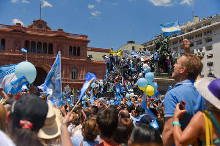 argentinean: Buenos Aires, Argentina - Dec 10, 2015: Supporters of the newly elected Argentinean president wave flags on inauguration day at the Plaza de Mayo.