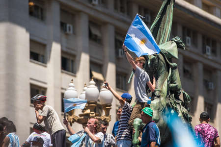 elected: Buenos Aires, Argentina - Dec 10, 2015: Supporters of the newly elected Argentinean president wave flags on inauguration day at the Plaza de Mayo.