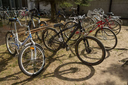 tensor: Dubna, Russia - Jul 21, 2014: Bicycles at bike-stand near the Tensor factory.