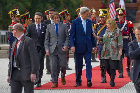 foreign secretary: Buenos Aires, Argentina - Aug 4, 2016: US Secretary of State John Kerry (C), Argentine Foreign Minister Susana Malcorra (R) and the Secretary of Government of Buenos Aires Fernando Diego Straface (L). Editorial