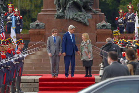 Buenos Aires, Argentina - Aug 4, 2016: US Secretary of State John Kerry (C), Argentine Foreign Minister Susana Malcorra (R) and the Secretary of Government of Buenos Aires Fernando Diego Straface (L). Banco de Imagens - 60818466