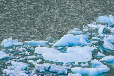 silty: Melting blue ice floes in the water in the Argentine Patagonia.