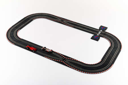 formula one: Moscow, Russia - Aug 14, 2010: Slot car racing track with formula one cars.