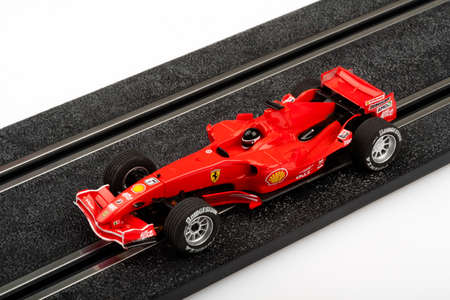 slot car track: Moscow, Russia - Aug 14, 2010: Slot car racing track with red formula one car.