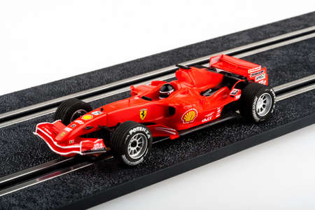 formula one racing: Moscow, Russia - Aug 14, 2010: Slot car racing track with red formula one car.