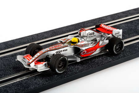 formula one: Moscow, Russia - Aug 14, 2010: Slot car racing track with silver formula one car. Editorial
