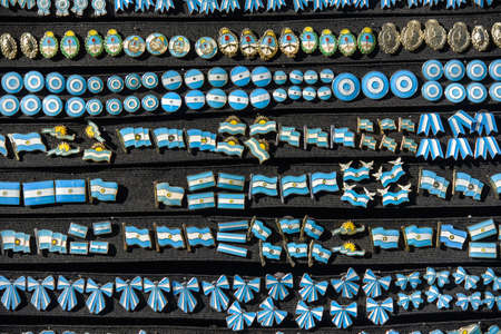 A lot of Argentine pins on black board at the Feria de Mataderos Fair sunday fair in Buenos Aires, Argentina.
