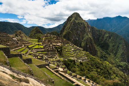 View of the Lost Incan City of Machu Picchu near Cusco, Peru. Machu Picchu is a Peruvian Historical Sanctuary. Terraces can be seen on foreground. Stock Photo