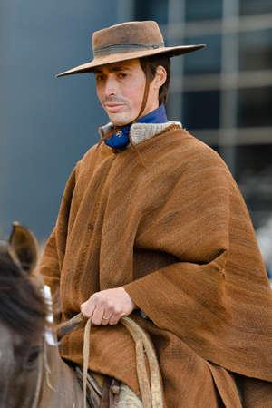 Buenos Aires, Argentina - Jul 16, 2016: Portrait of a gaucho cowboy riding a horse during a show at the Rural Exhibition. Banco de Imagens - 71117820