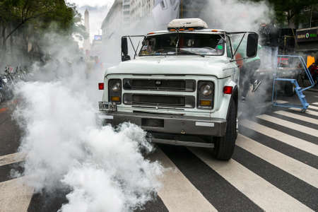 steam rally: Buenos Aires, Argentina - 2 Sept, 2016: Truck in a smoke during protest of the worker unions against dismissals, tax rising and inflation.