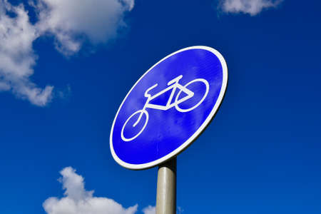 cycleway: Bicycle road sign on a blue sky background