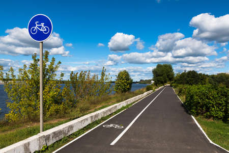 Bicycle road on a riverwalk along the Volga River in the city of Dubna, Moscow Oblast, Russia. Stock Photo