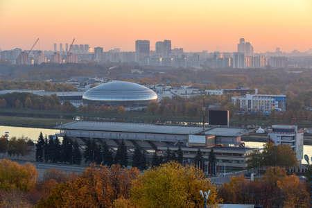 Skyline view of the Krylatskoye Rowing Canal and Krylatskoye Sports Palace at dawn.