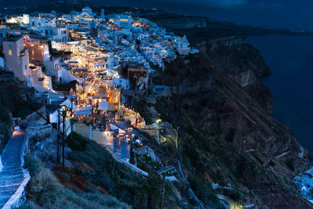 Santorini at night on the cliff Above the sea, Greek Islands, Greece photo