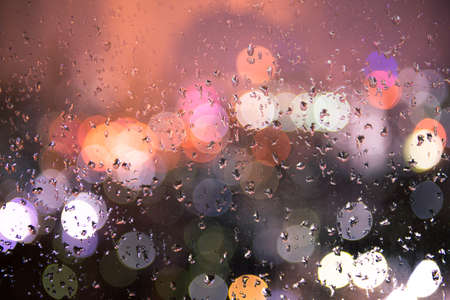 round window: bokeh light with rain