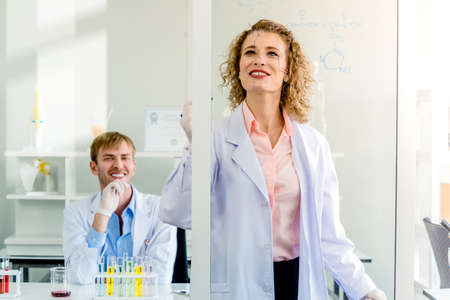 Scientists teamwork with senior brainstorming teaching and research laboratory in lab